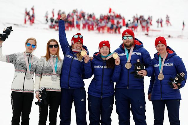 Alpine Skiing - Pyeongchang 2018 Winter Paralympics - Women's Slalom - Visually Impaired - Jeongseon Alpine Centre - Jeongseon, South Korea - March 18, 2018 - Gold medallist Menna Fitzpatrick (7) of Britain and her guide Jennifer Kehoe, silver medallist Henrieta Farkasova (6) of Slovakia and her guide Natalia Subrtova, and bronze medallist Millie Knight (5) of Britain and her guide Brett Wild. REUTERS/Paul Hanna