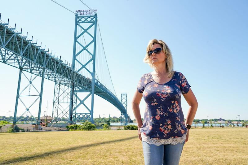 """""""I almost feel like we're being penalized because we chose this type of relationship Kim Thompson of Ferndale said, who has been separated from her partner who lives in Harrow Ontario, Canada for months due to the pandemic and their inability to cross the U.S./Canada border."""