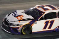 Denny Hamlin (11) drives his damaged car into Turn 4 during the NASCAR Cup Series auto race Saturday, Sept. 19, 2020, in Bristol, Tenn. (AP Photo/Steve Helber)