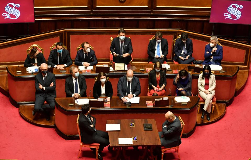 Premier Giuseppe Conte, top center, delivers his speech at the Senate, in Rome, Tuesday, Jan. 19, 2021. Conte fights for his political life with an address aimed at shoring up support for his government, which has come under fire from former Premier Matteo Renzi's tiny but key Italia Viva (Italy Alive) party over plans to relaunch the pandemic-ravaged economy. (Andreas Solaro/Pool via AP)