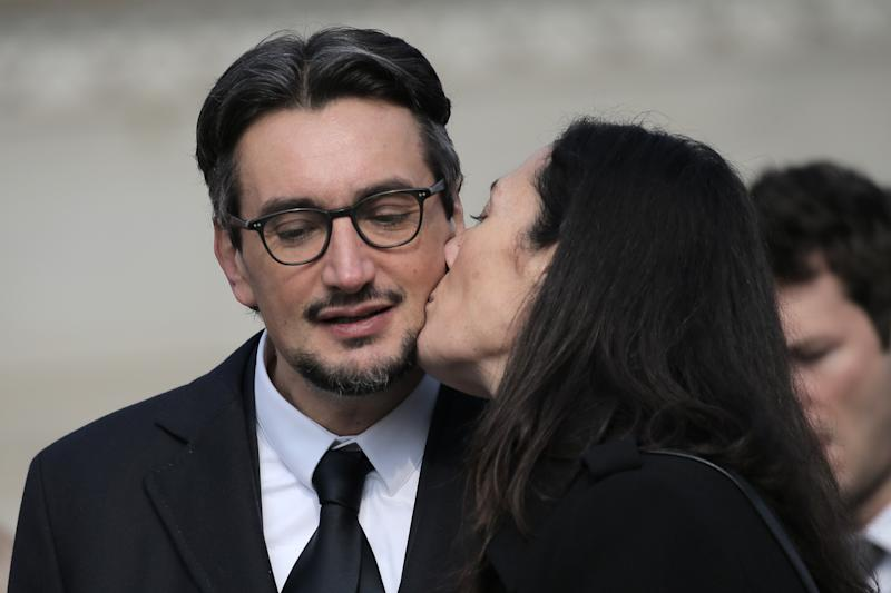 The son of Michele Ferrero, Giovanni Ferrero (L) receives a kiss from his wife Paola during the funeral of his father on February 18, 2015 in Alba, northern Italy. Billionaire Michele Ferrero, who became Italy's richest man with a confectionary empire built on his popular Nutella spread, has died at the age of 89. Ferrero had been battling illness for several months. He died in Monte Carlo on February 15, 2015. AFP PHOTO / MARCO BERTORELLO (Photo credit should read MARCO BERTORELLO/AFP via Getty Images)