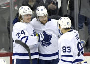Toronto Maple Leafs right wing William Nylander (88) celebrates his winning goal in overtime with Kasperi Kapanen (24) and Cody Ceci (83) in an NHL hockey game against the New Jersey Devils, Friday, Dec. 27, 2019, in Newark, N.J. (AP Photo/Bill Kostroun)