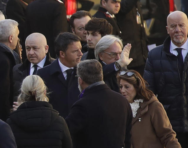 <p>Former premier and Democratic Party president Matteo Renzi, center, arrives with Fiorentina owner Diego Della Valle, for the funeral ceremony of Italian player Davide Astori in Florence, Italy, Thursday, March 8, 2018. The 31-year-old Astori was found dead in his hotel room on Sunday after a suspected cardiac arrest before his team was set to play an Italian league match at Udinese. (AP Photo/Alessandra Tarantino) </p>