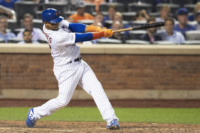 New York Mets' Juan Lagares hits a single during the ninth inning of the team's baseball game against the Cleveland Indians, Wednesday, Aug. 21, 2019, in New York. (AP Photo/Mary Altaffer)