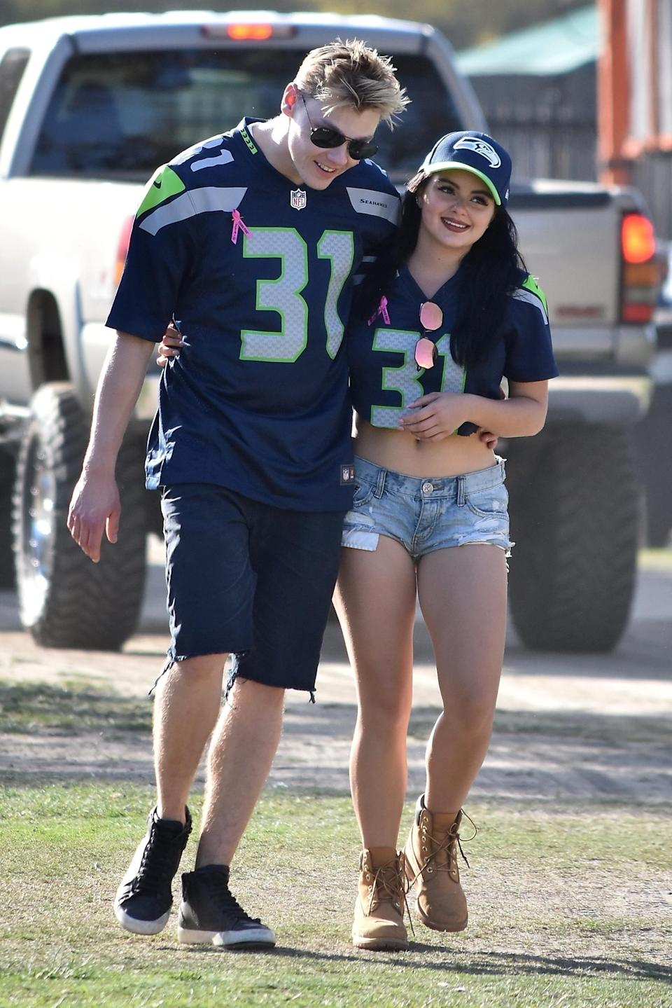 <p>The <i>Modern Family </i>actress and boyfriend, Levi Meaden, wore matching Seattle Seahawks jerseys with their names written on the back of them Sunday, as they watched their team defeat the L.A. Rams at home. (Photo: AKM-GSI) </p>