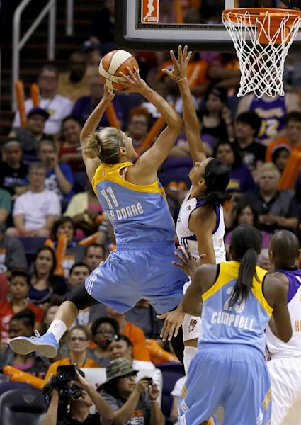 Chicago Sky's Elena Delle Donne (11) scores over Phoenix Mercury's Candice Dupree as the Sky's Michelle Campbell (25) looks on in the first half during a WNBA basketball game on Monday, May 27, 2013, in Phoenix. (AP Photo/Ross D. Franklin)