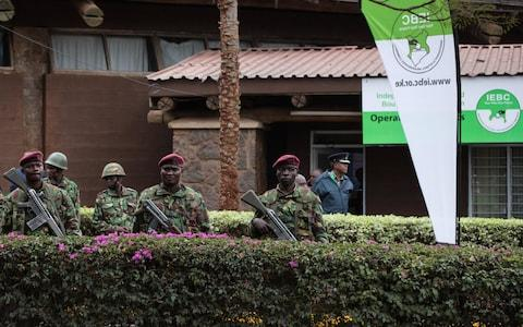 Kenya police officers stand guard ahead of Friday's announcement - Credit: EPA
