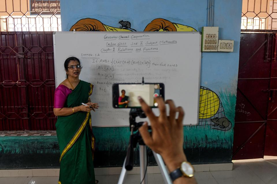 A school teacher gives a live streaming online class at a government school after the government eased a nationwide lockdown imposed as a preventive measure against the COVID-19 coronavirus, in Chennai on June 3, 2020. (Photo by Arun SANKAR / AFP) (Photo by ARUN SANKAR/AFP via Getty Images)