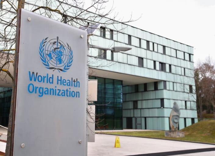 A logo is pictured outside a building of the WHO in Geneva