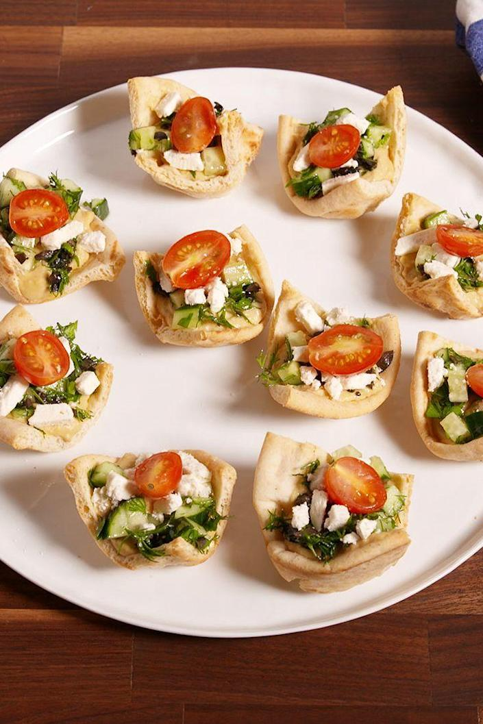 """<p>Put your muffin tin to use with this ridiculously easy snack!</p><p>Get the recipe from <a href=""""https://www.delish.com/cooking/recipes/a50741/greek-pita-cups-recipe/"""" rel=""""nofollow noopener"""" target=""""_blank"""" data-ylk=""""slk:Delish"""" class=""""link rapid-noclick-resp"""">Delish</a>. </p>"""