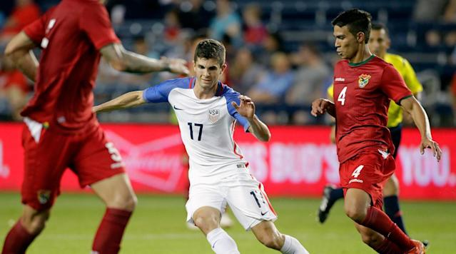<p>Christian Pulisic of the USA attempts to drive past Diego Bejarano of Bolivia during the second half of an international friendly soccer match at Children's Mercy Park on May 28, 2016 in Kansas City.</p>