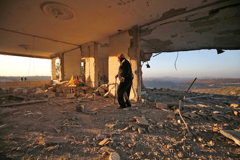 A man looks at the remains of the house of Palestinian assailant Nimer Aljamal after it was destroyed by Israeli troops in the occupied West Bank village of Beit Surik near Jerusalem on November 15, 2017 (AFP Photo/ABBAS MOMANI)
