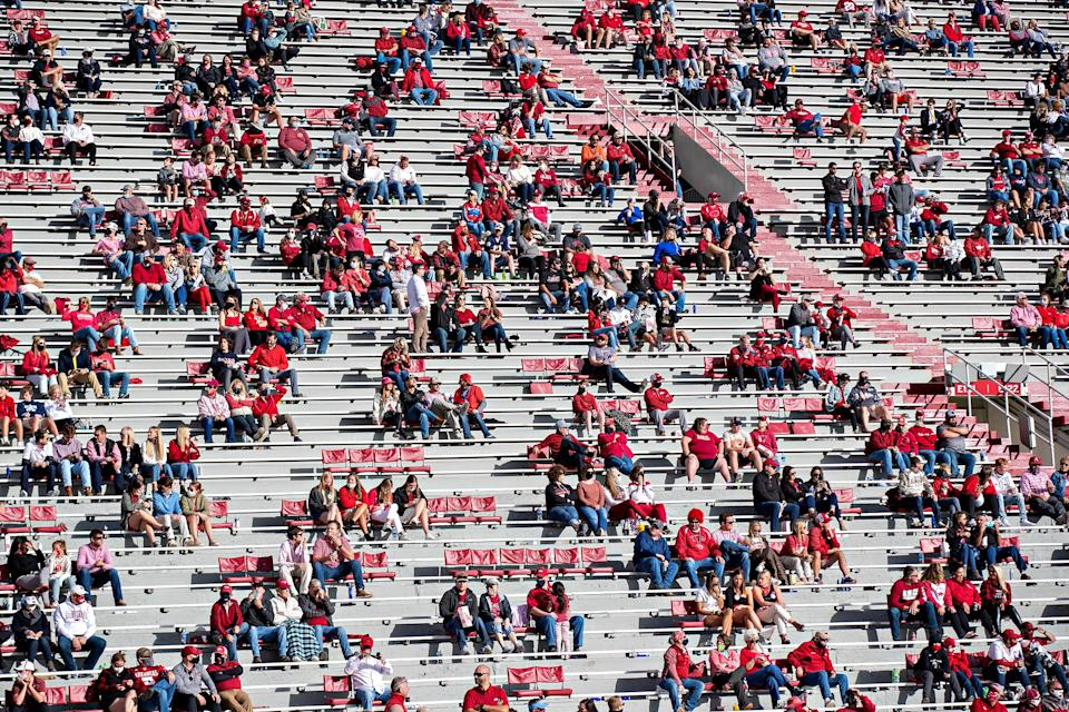 Socially distanced groups of fans during a game between the Arkansas Razorbacks and the Mississippi Rebels in Fayetteville, Ark., on Oct. 17, 2020.