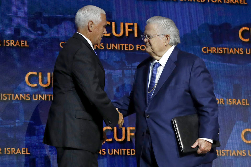 FILE - In this July 8, 2019 file photo, Vice President Mike Pence, left, greets Pastor John Hagee, founder and chairman of Christians United for Israel in Washington. Prominent Texas megachurch pastor and conservative activist John Hagee has been diagnosed with COVID-19. Hagee's son, Matt Hagee, announced the illness during Sunday, OCT. 4, 2020, morning services at Cornerstone Church, which his father founded. (AP Photo/Patrick Semansky File)