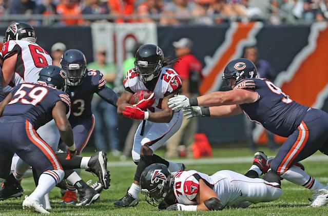<p>Atlanta Falcons running back Devonta Freeman (24) runs with the ball during the first quarter against the Chicago Bears at Soldier Field. Mandatory Credit: Dennis Wierzbicki-USA TODAY Sports </p>