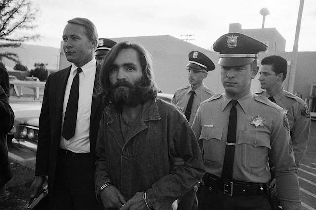 "<p>Charles Manson, leader of a hippie cult accused of multiple murders, leaves a Los Angeles courtroom on Dec. 22, 1969, after telling a judge ""Lies have been told"" about him. His followers said the 35-year-old ex-convict has hypnotic powers. At left is his public defender, Fred Schaefer. (Photo: Wally Fong/AP) </p>"
