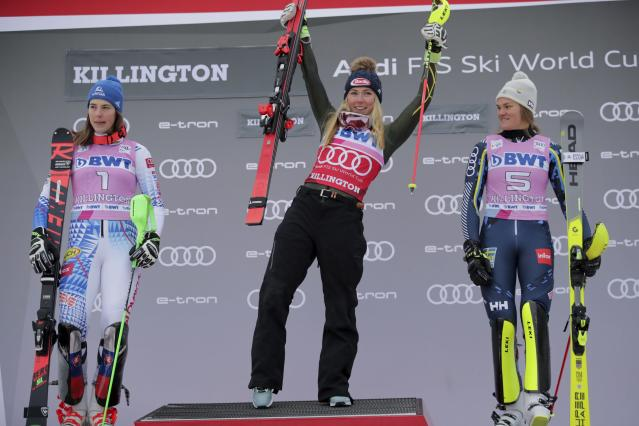 United States' Mikaela Shiffrin, center, winner of an alpine ski, women's World Cup slalom, poses on the podium with second placed Slovakia's Petra Vlhova, left, and third placed Sweden's Anna Swenn Larsson, in Killington, Vt., Sunday, Dec.1, 2019. (AP Photo/Charles Krupa)