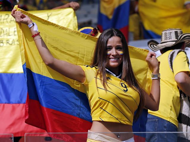A Colombian supporter smiles as she waits for the start of the group C World Cup soccer match between Colombia and Greece at the Mineirao Stadium in Belo Horizonte, Brazil, Saturday, June 14, 2014. (AP Photo/Jon Super)