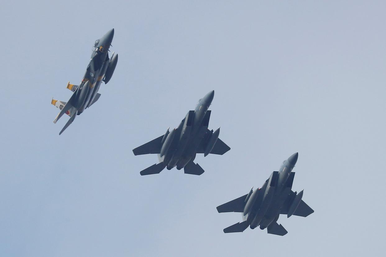 Image: FILE PHOTO: U.S. Air Force F-15 fighter jets fly in formation during the Clear Sky 2018 multinational military drills in Khmelnytskyi Region
