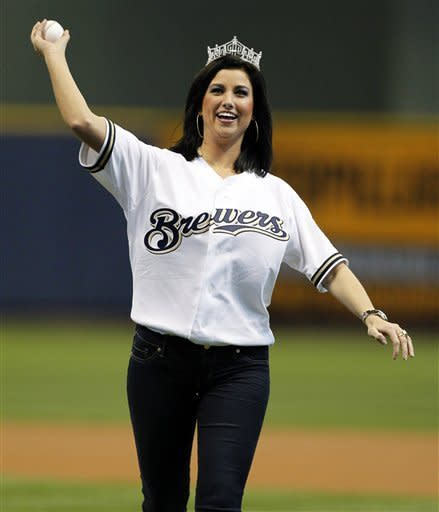 Miss America Laura Kaeppeler throws out the ceremonial first pitch before an opening day baseball game between the Milwaukee Brewers and St. Louis Cardinals, Friday, April 6, 2012, in Milwaukee. (AP Photo/Jeffrey Phelps)