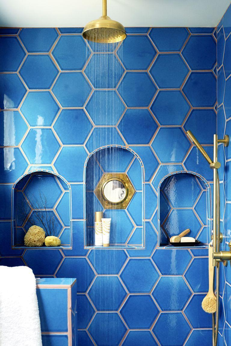 "<p>Don't have any space for seating or shelving in your shower? Try installing niches to store your toiletries. Using the wall space means you'll have more room to enjoy your shower in. Plus, you can have a little fun with tiling and shapes, like designer <a href=""http://www.justinablakeney.com/"" rel=""nofollow noopener"" target=""_blank"" data-ylk=""slk:Justina Blakeney"" class=""link rapid-noclick-resp"">Justina Blakeney</a> did with this .</p>"