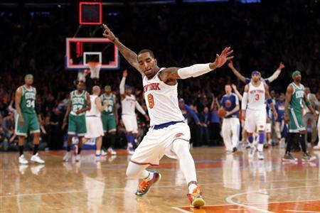 New York Knicks' J.R. Smith celebrates after sinking a three point basket at the buzzer at the end of the first quarter against the Boston Celtics in Game 2 of their NBA Eastern Conference basketball playoff series in New York, April 23, 2013. REUTERS/Mike Segar