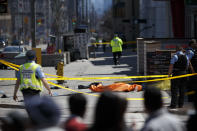 <p>A tarp lays on top of a body on Yonge St. at Finch Ave. after a van plowed into pedestrians in Toronto. Cole Burston/Getty Images </p>