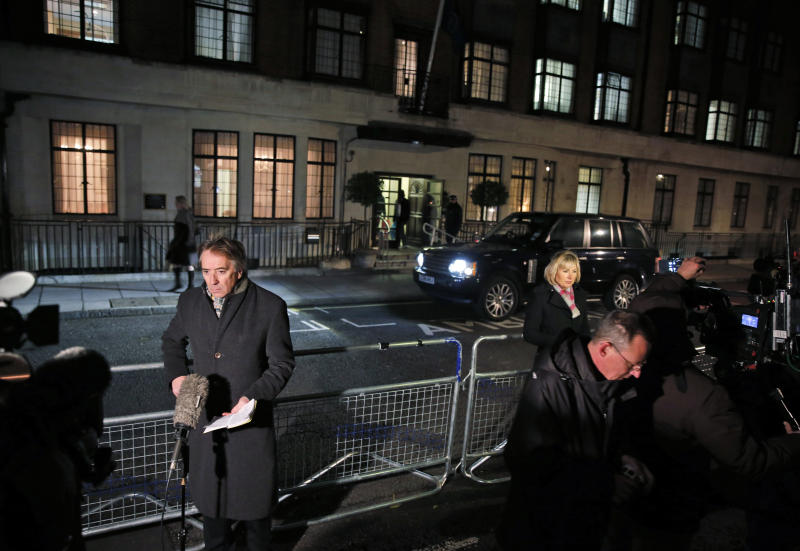 Members of the media opposite the entrance to the King Edward VII hospital in central London, Friday, Dec. 7, 2012. King Edward VII hospital says a nurse involved in a prank telephone call to elicit information about the Duchess of Cambridge has died. The hospital said Friday that Jacintha Saldanha had been a victim of the call made by two Australian radio disc jockeys. They did not immediately say what role she played in the call. (AP Photo/Lefteris Pitarakis)