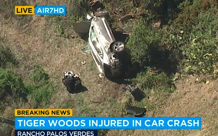 US media footage showed the car flipped onto its side near the road in Los Angeles - AP