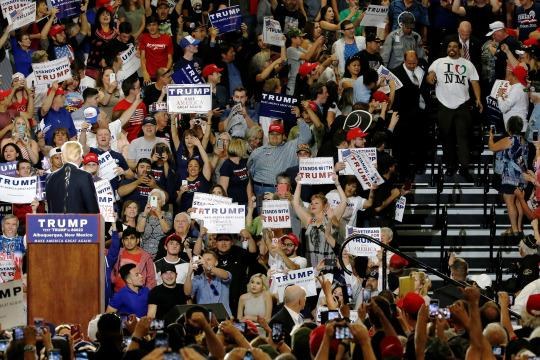 A protester (right) disrupts a rally with Donald Trump and his supporters in Albuquerque, N.M., on May 24. (Photo: Jonathan Ernst/Reuters)