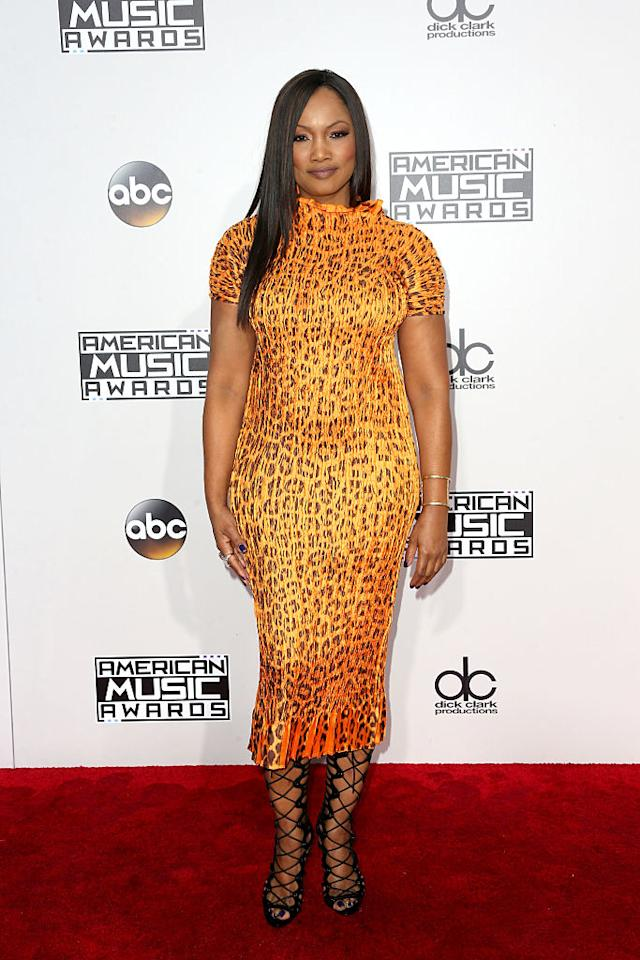 <p>Garcelle Beauvais's leopard print dress hugged her curves in all the right places. <em>(Photo: Getty Images)</em> </p>