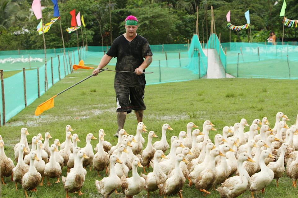 """""""They Thought Godzilla Was Walking Down the Street (Japan/Vietnam)"""" -- Matt performs a Roadblock in which he must participate in the Mekong duck herding festival in order to receive their next clue during the season premiere of THE AMAZING RACE 15 on Sunday, Sept. 27 (8:00-10:00 PM, ET/PT) on the CBS Television Network. Photo: Monty Brinton/CBS ©2009 CBS Broadcasting Inc. All Rights Reserved."""