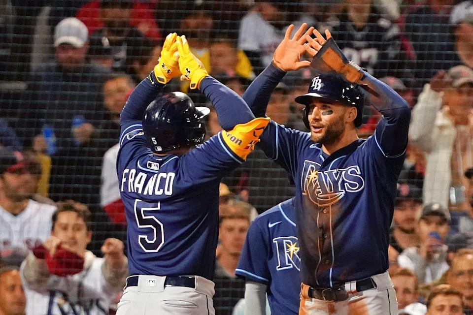 Rays shortstop Wander Franco (5) celebrates with Kevin Kiermaier (39) hitting a two-run home run against the Red Sox in Game 4 of the ALDS.