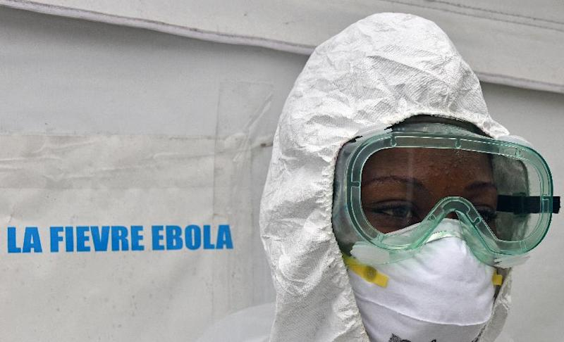 A health worker poses inside a tent in the Ebola treatment unit being preventively set up to host potential Ebola patients at the University Hospital of Yopougon, on October 17, 2014