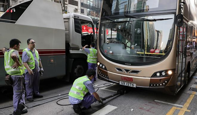 KMB staff servicing stalled buses in Mong Kok. Photo: Edmond So
