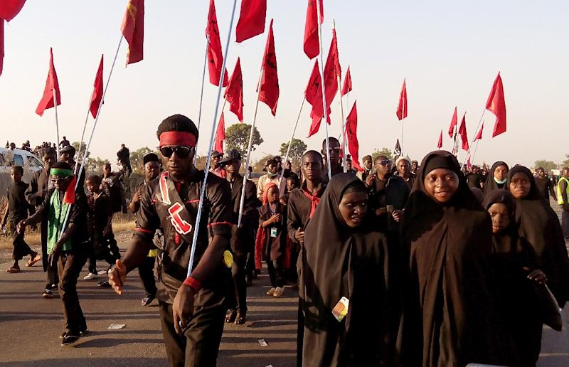 Shiite Muslims march on the highway during a procession commemorating the 40th anniversary of the Ashura religious ceremony on November 27, 2015 in the village of Dakasoye, northern Nigeria, following a suicide bombing attack (AFP Photo/Aminu Abubakar)