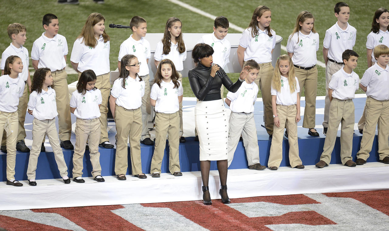 Jennifer Hudson and a choir from Newtown, Connecticut, perform before the start of Super Bowl XLVII at the Mercedes-Benz Superdome in New Orleans, Louisiana, Sunday, February 3, 2013. (Harry E. Walker/MCT)
