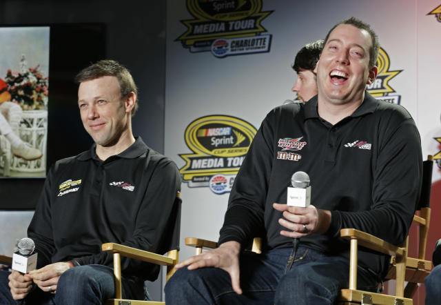 Drivers Kyle Busch, right, and Matt Kenseth, left, share a laugh during a news conference at the NASCAR Sprint Cup auto racing Media Tour in Charlotte, N.C., Thursday, Jan. 30, 2014. (AP Photo)
