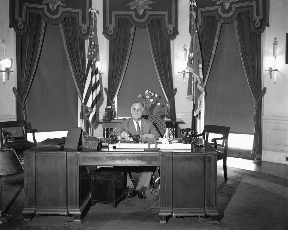 President Franklin D. Roosevelt is shown at his desk at the White House, May 27, 1933.  (AP Photo)