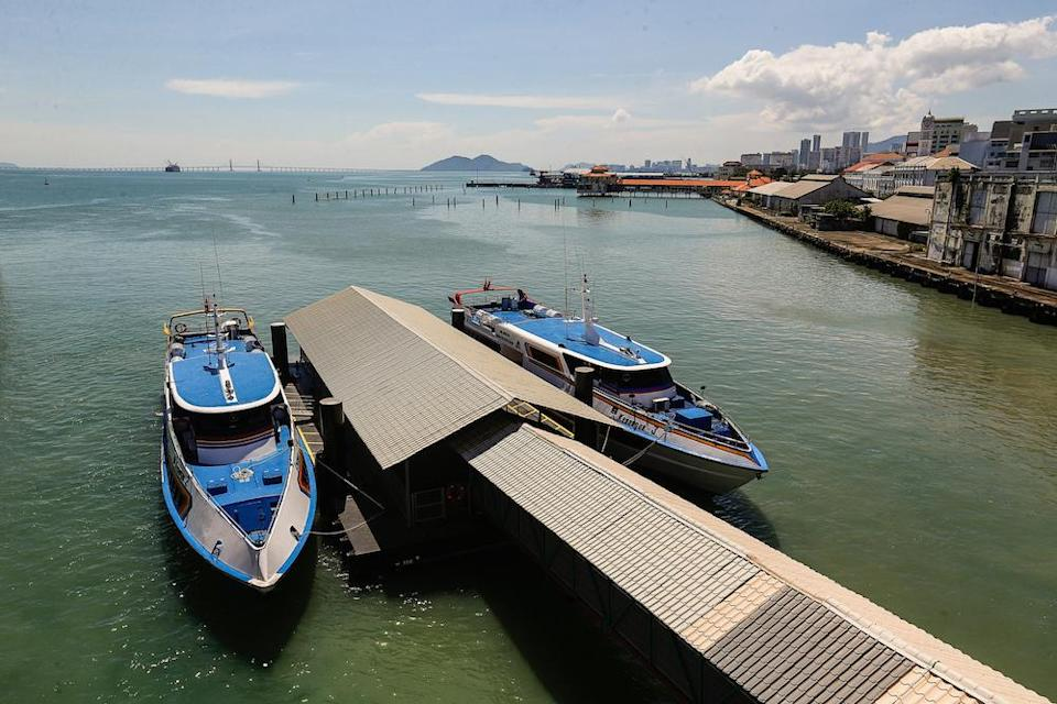 The new fast boats which will be replacing the old ferries are seen docked here at Swettenham Pier, December 28, 2020. — Picture by Sayuti Zainudin