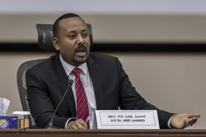 """Ethiopia's Prime Minister Abiy Ahmed responds to questions from members of parliament at the prime minister's office in the capital Addis Ababa, Ethiopia Monday, Nov. 30, 2020. The fugitive leader of Ethiopia's defiant Tigray region on Monday called on Prime Minister Abiy Ahmed to withdraw troops from the region as he asserted that fighting continues """"on every front"""" two days after Abiy declared victory. (AP Photo/Mulugeta Ayene)"""