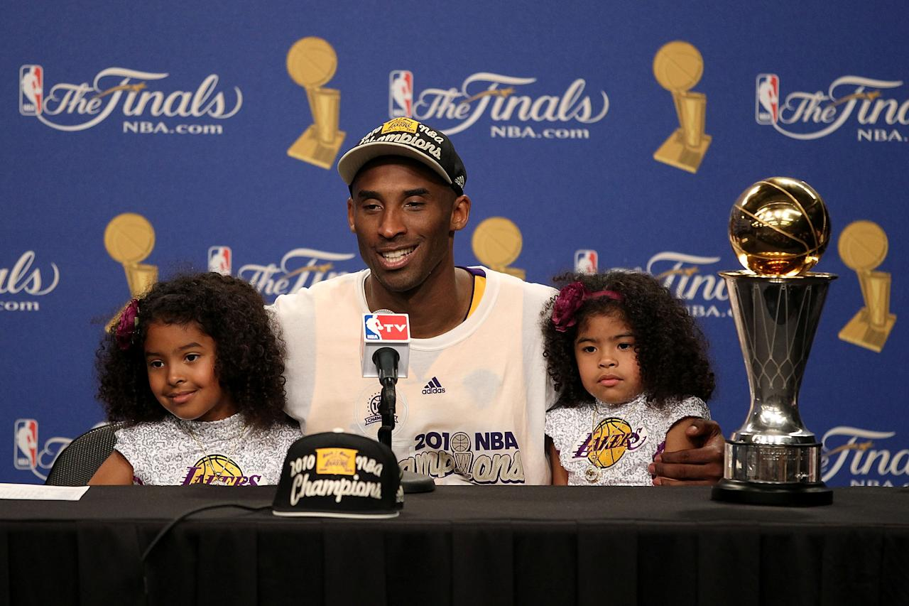 Kobe Bryant speaks during the post game news conference with daughters Natalia and Gianna Bryant after winning Game Seven of the 2010 NBA Finals at Staples Center on June 17, 2010 in Los Angeles, (Photo by Christian Petersen/Getty Images)