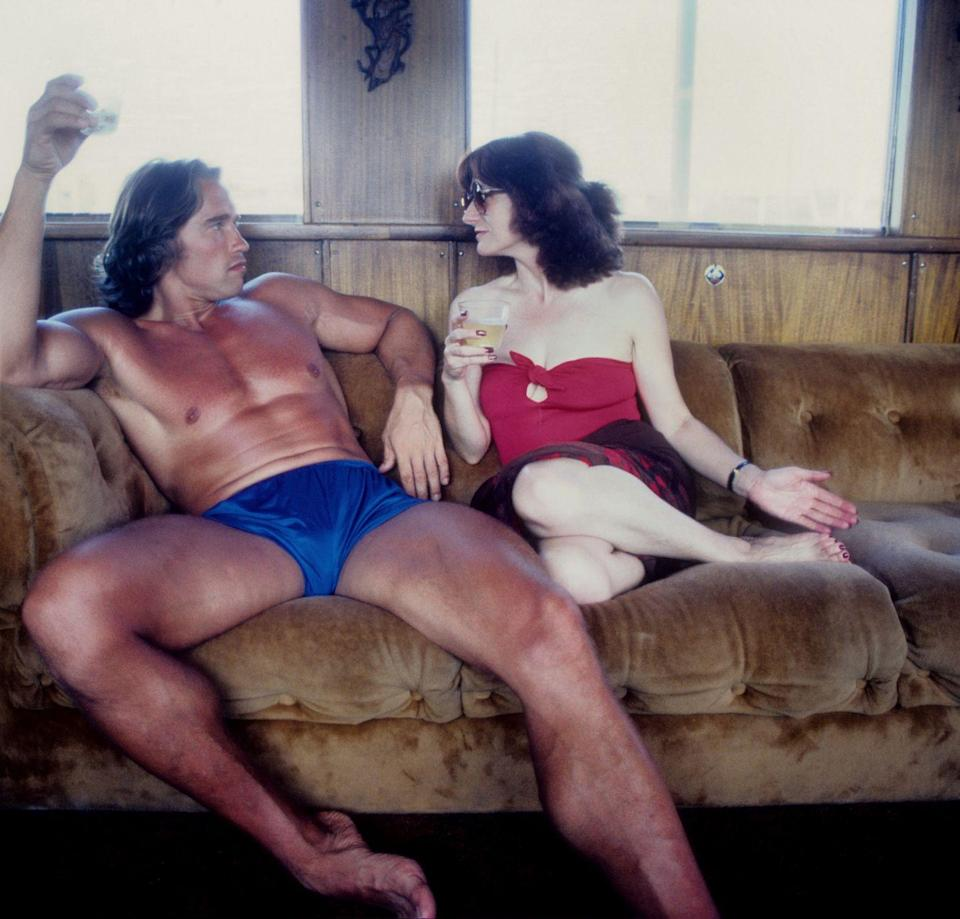 <p>Arnold Schwarzenegger lounges in his bathing suit, while spending the day on a yacht with a female friend in 1979. </p>