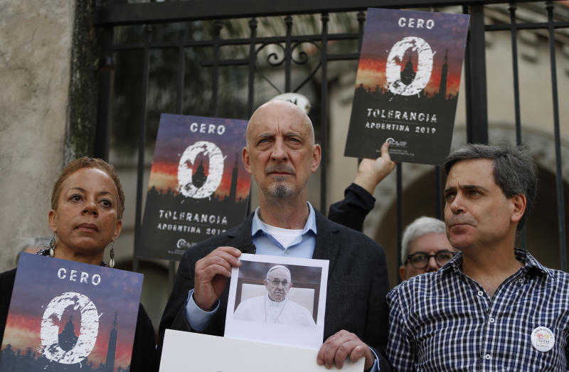 "Members of the organization called Ending Clergy Abuse, Denise Buchanan, left, and Peter Isely, center, stand with Sebastian Cuattromo, a victim of sexual abuse at a religious school when he was a youth by a teacher who was found guilty, as they stand outside a church in Buenos Aires, Argentina, Thursday, May 2, 2019. The three are demanding Pope Francis ""zero tolerance"" regarding abuse and an end to what they see as cover ups by members of the church. (AP Photo/Natacha Pisarenko)"