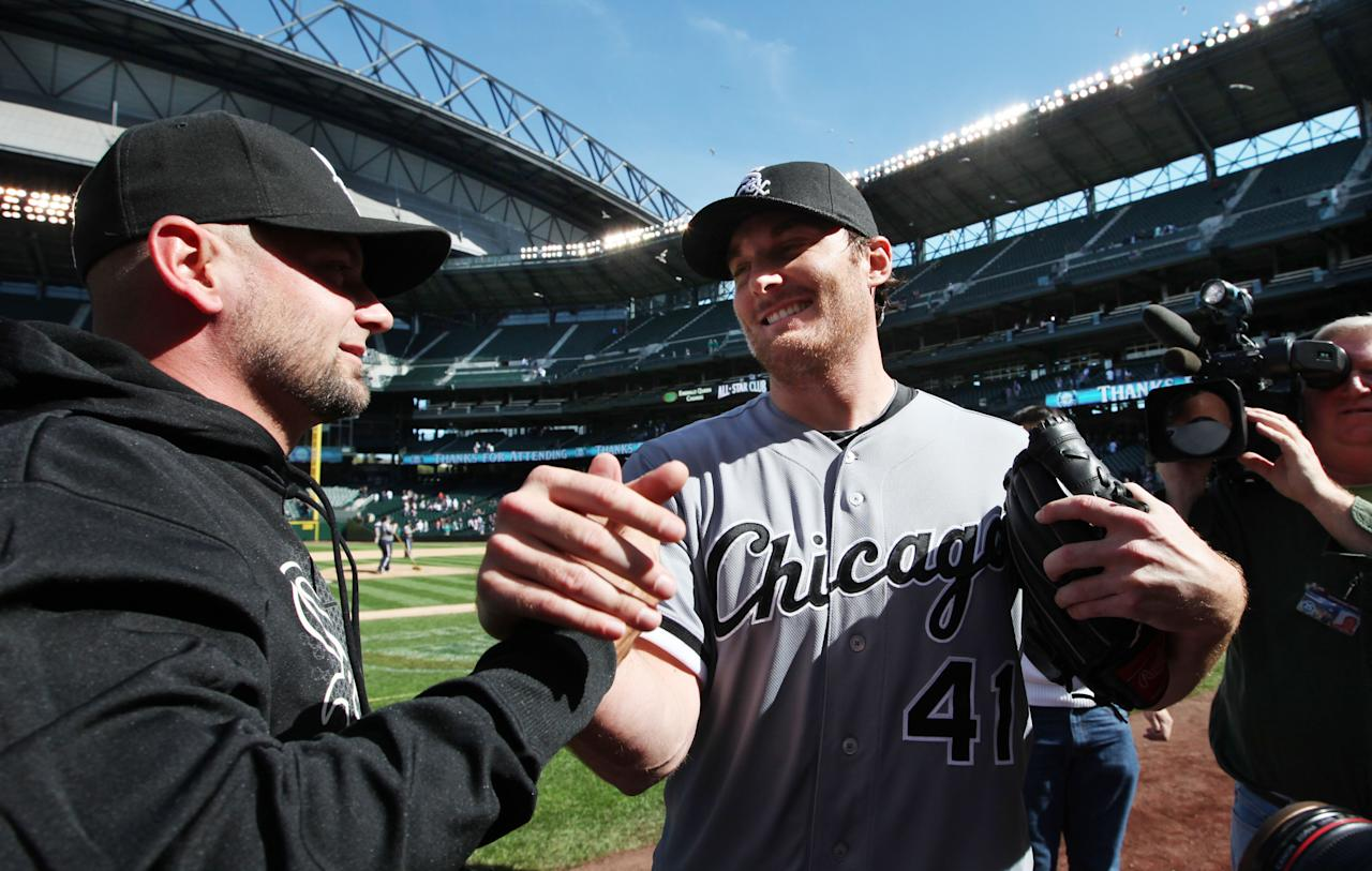Chicago White Sox starting pitcher Phil Humber (41) is congratulated after pitching a perfect baseball game against the Seattle Mariners, Saturday, April 21, 2012, in Seattle. The White Sox won 4-0. (AP Photo/Elaine Thompson)