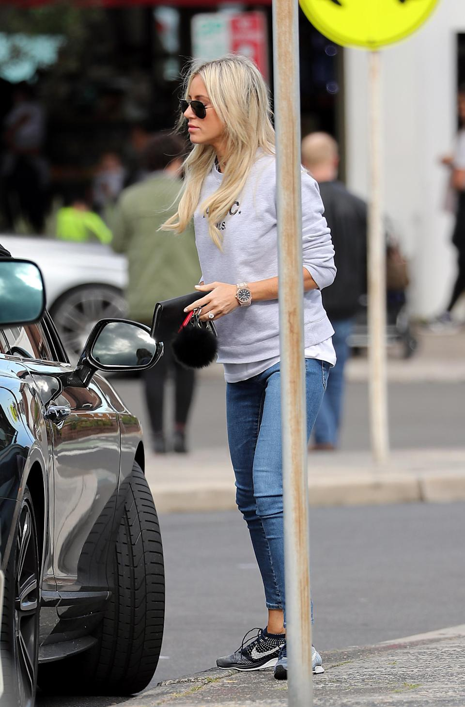 The blonde bombshell was dressed casually in a grey sweatshirt and jeans.