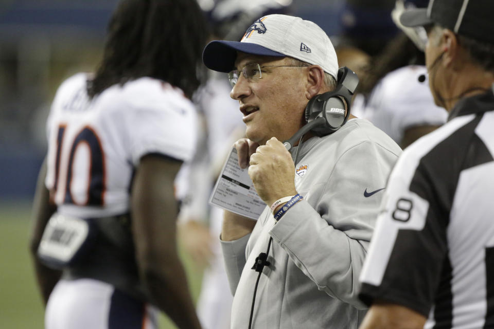 Denver Broncos head coach Vic Fangio wears a headset on the sideline during the first half of an NFL preseason football game against the Seattle Seahawks, Saturday, Aug. 21, 2021, in Seattle. (AP Photo/Jason Redmond)