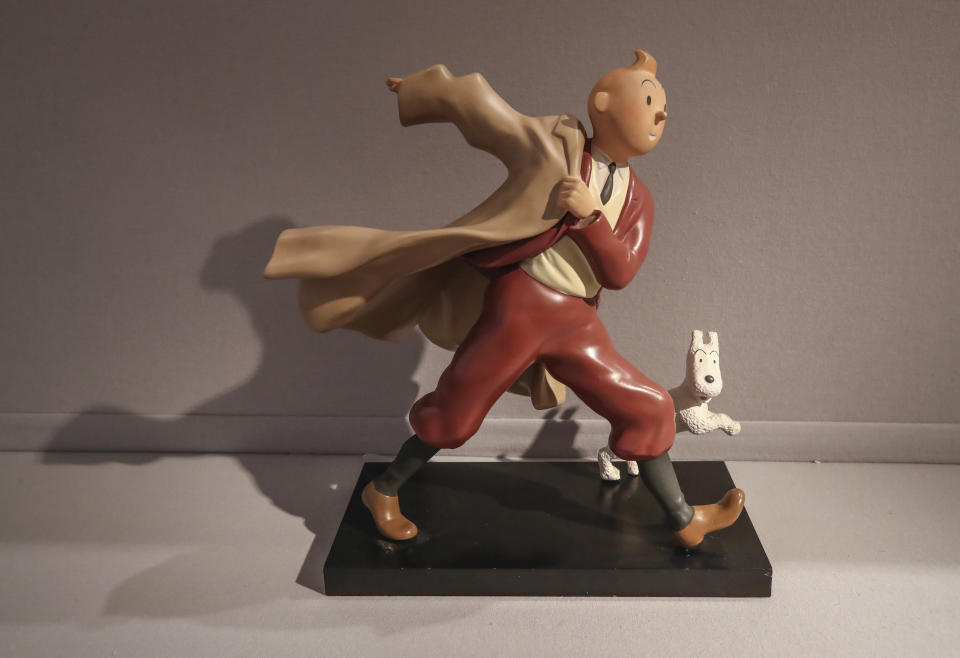 """A 1988 polychrome resin sculpture of the comic character Tintin and his dog snowy from the 1941 """"The Crab with the Golden Claws"""" album drawn by Belgian creator Herge is displayed at the Artcurial auction house in Paris, Wednesday, Jan. 13, 2021. The art work with an estimates value of 400 to 900 million euros (US $ 486 to 1095), is going on sale Thursday. (AP Photo/Michel Euler)"""