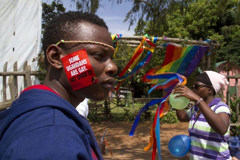 A Ugandan man with a sticker on his face takes part on August 9, 2014 in the annual gay pride in Entebbe, Uganda. (SAAC KASAMANI/AFP/Getty Images)