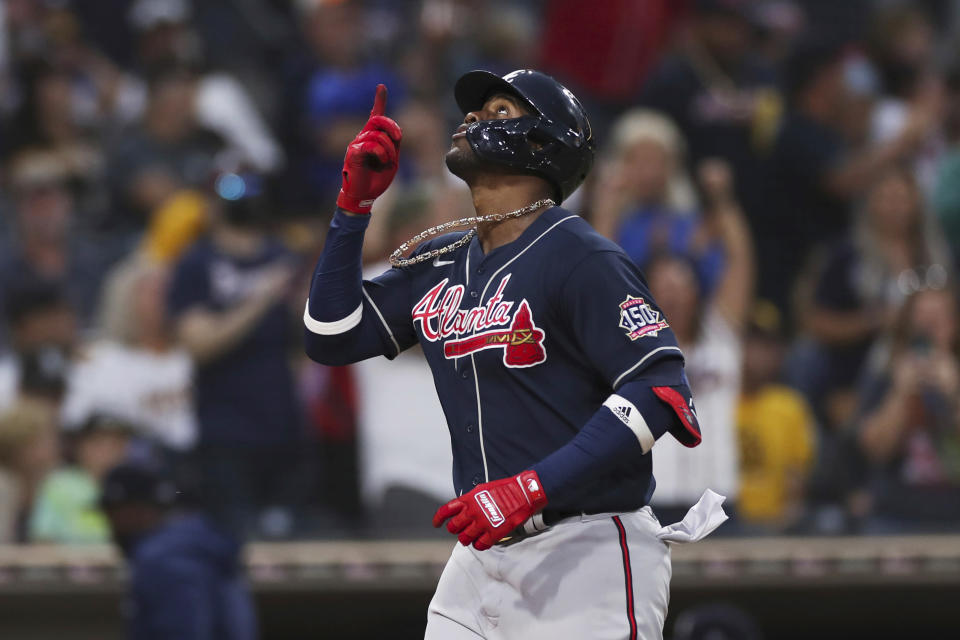 Atlanta Braves' Jorge Soler gestures to the sky as he nears home plate after hitting a three run home run against the San Diego Padres in the sixth inning of a baseball game Saturday, Sept. 25, 2021, in San Diego. (AP Photo/Derrick Tuskan)